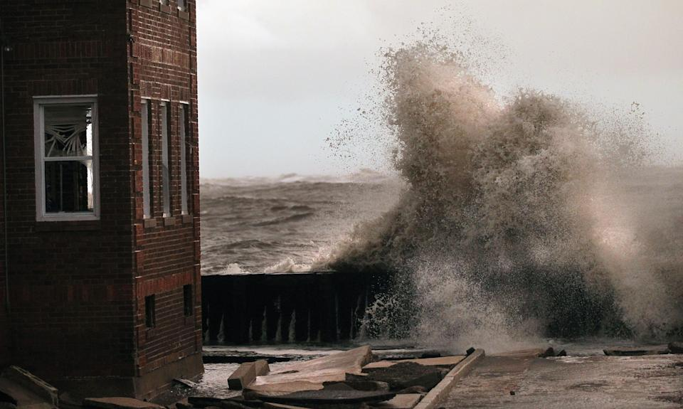 Waves break next to an Atlantic City, New Jersey, apartment building that flooded when the giant storm hit. (Mario Tama/Getty Images)