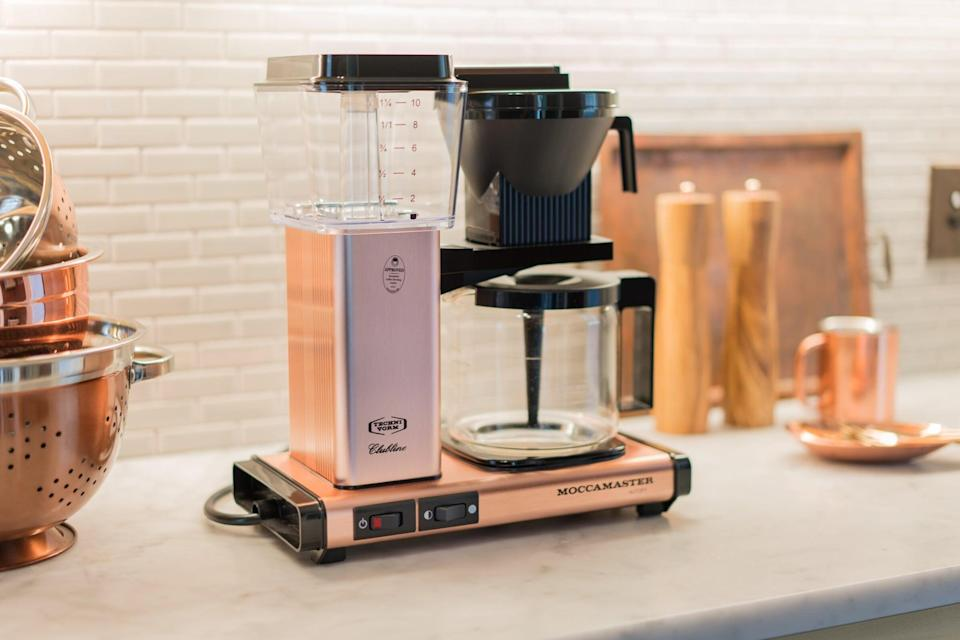 <p>If they're a coffee fan, get them the cool <span>Moccamaster 10-Cup Coffee Maker</span> ($329).</p>