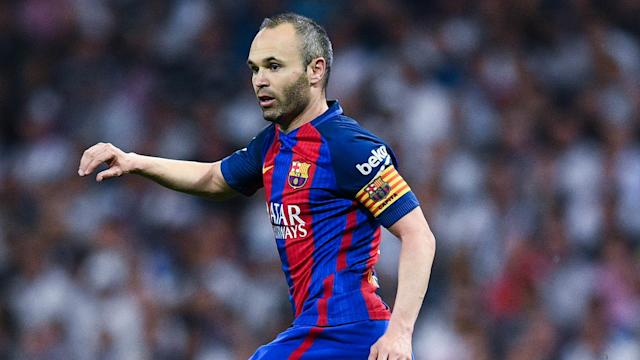 """Denying any talk of any problems during contract talks, Andres Iniesta says he is mind is on """"continuing to have glory"""" with Barcelona."""