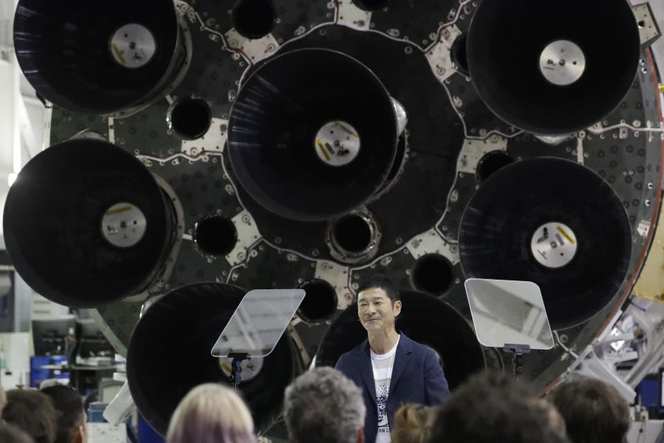 FILE - In this Monday, Sept. 17, 2018 file photo, Japanese billionaire Yusaku Maezawa speaks after SpaceX founder and chief executive Elon Musk announced him as the person who would be the first private passenger on a trip around the moon in Hawthorne, Calif. (AP Photo/Chris Carlson)