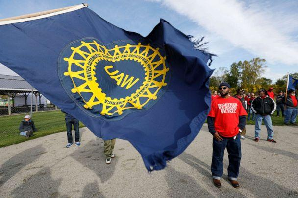 PHOTO: United Auto Workers union members and their families rally near the General Motors Flint Assembly plant on Solidarity Sunday on Oct. 13, 2019 in Flint, Mich. (Bill Pugliano/Getty Images)