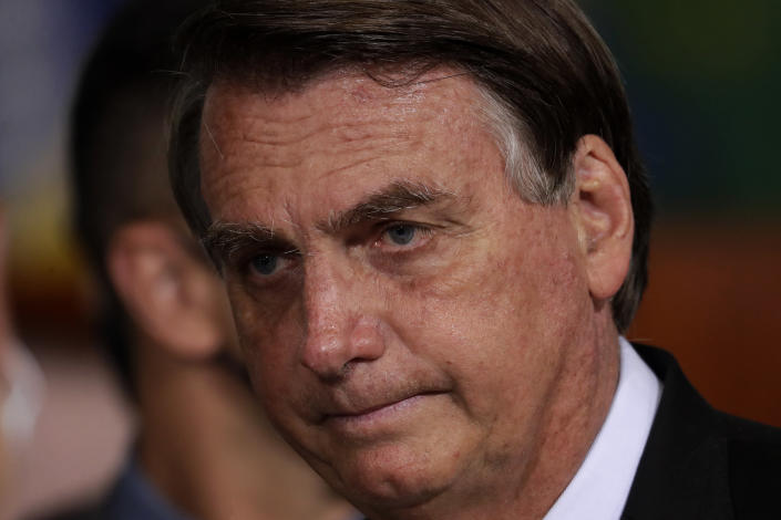 FILE - In this June 29, 2021 file photo, Brazilian President Jair Bolsonaro attends a government ceremony at Planalto presidential palace in Brasilia, Brazil. With the presidential election 15 months off, Bolsonaro has often raised the specter of fraud, warning that unless Congress overhauls the voting system he will be entitled to reject the results, and has begun floating the possibility of canceling the election. (AP Photo/Eraldo Peres, File)