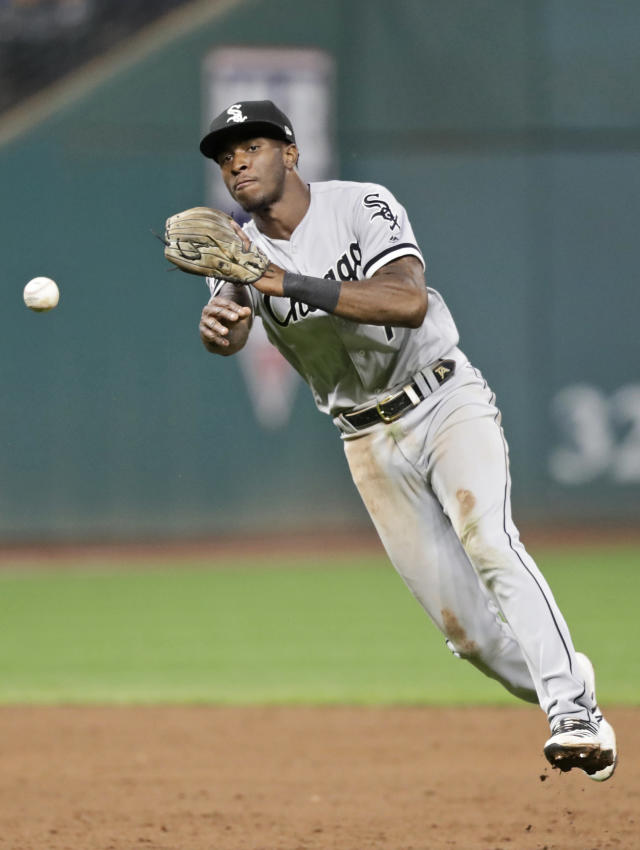 Chicago White Sox's Tim Anderson throws out Cleveland Indians' Yasiel Puig at first base in the seventh inning in a baseball game, Monday, Sept. 2, 2019, in Cleveland. (AP Photo/Tony Dejak)