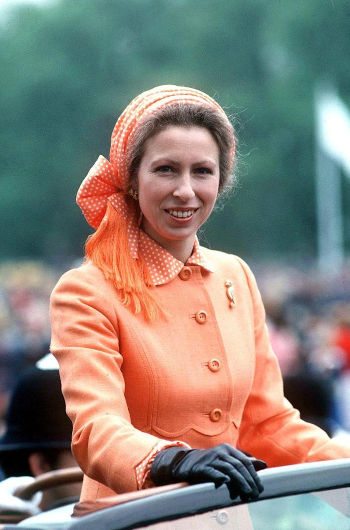 <p>Princess Anne looks positively peachy in a sherbet orange look. </p>