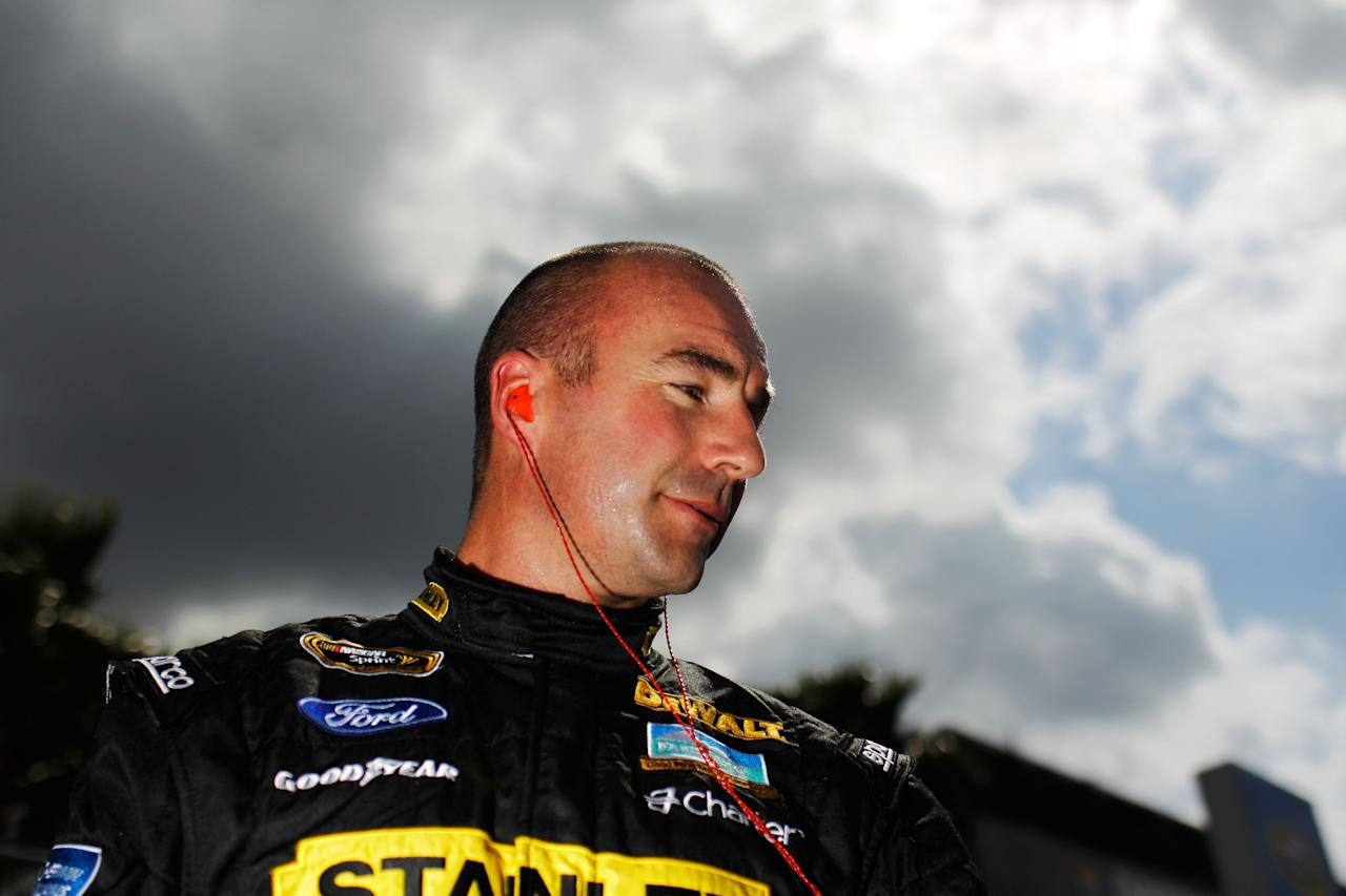 DAYTONA BEACH, FL - FEBRUARY 19:  Marcos Ambrose, driver of the #9 Stanley Ford, looks on after qualifying for the NASCAR Sprint Cup Series Daytona 500 at Daytona International Speedway on February 19, 2012 in Daytona Beach, Florida.  (Photo by Tom Pennington/Getty Images for NASCAR)