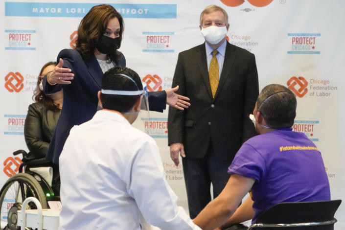 Vice President Kamala Harris talks with Lucio Polanco, a high-rise window washer, as he received the Johnson & Johnson COVID-19 vaccination from Osman Meah at COVID-19 vaccination site, Tuesday, April 6, 2021, in Chicago. Watching are Sen. Tammy Duckworth, D-Ill., left, and Sen. Dick Durbin, D-Ill. The site is a partnership between the City of Chicago and the Chicago Federation of Labor. (AP Photo/Jacquelyn Martin)