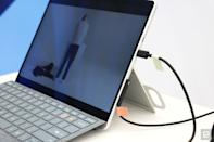 <p>A side view of the wires going into a Surface Pro with tabs from the Surface Adaptive Kit in lime and orange.</p>