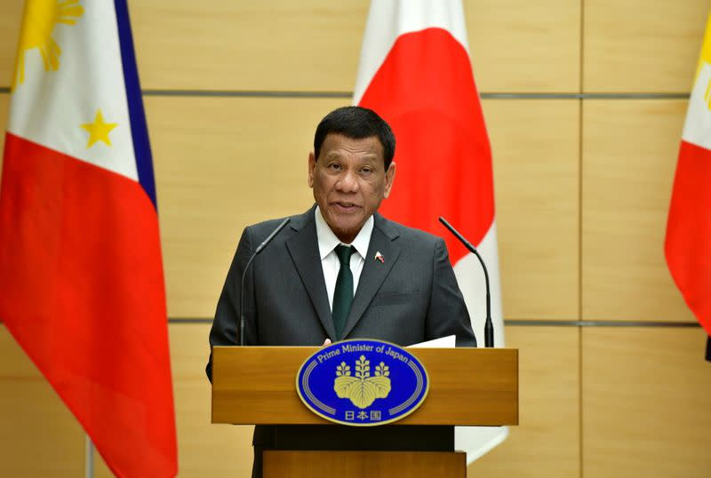 FILE PHOTO: Philippine President Rodrigo Duterte delivers a speech during their joint press statement with Japan's Prime Minister Shinzo Abe in Tokyo