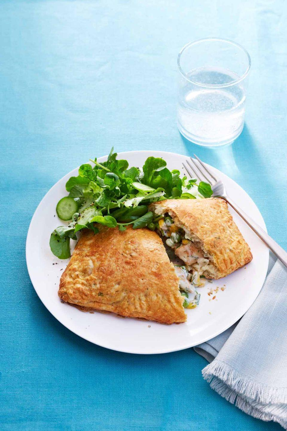 """<p>These chicken pot pie turnovers transform the classic comfort food into a dish fancy enough for a special occasion. </p><p><em><a href=""""https://www.womansday.com/food-recipes/food-drinks/recipes/a54438/chicken-pot-pie-turnovers-recipe/"""" rel=""""nofollow noopener"""" target=""""_blank"""" data-ylk=""""slk:Get the recipe for Chicken Pot Pie Turnovers."""" class=""""link rapid-noclick-resp"""">Get the recipe for Chicken Pot Pie Turnovers.</a> </em><br></p>"""
