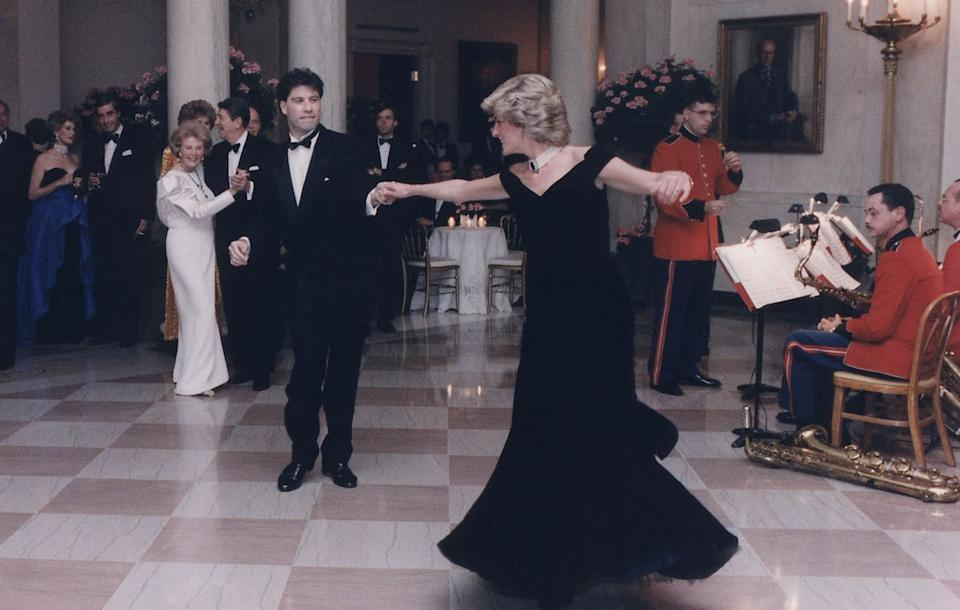 Princess Diana dancing with John Travolta after a White House dinner for the Prince and Princess of Wales. Nov. 9 1985.