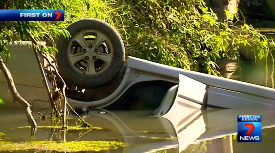 The family car flipped and landed on the roof in the creek. Photo: 7 News
