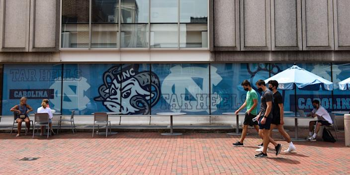 Students walk through the campus of the University of North Carolina at Chapel Hill on August 18, 2020 in Chapel Hill, North Carolina.