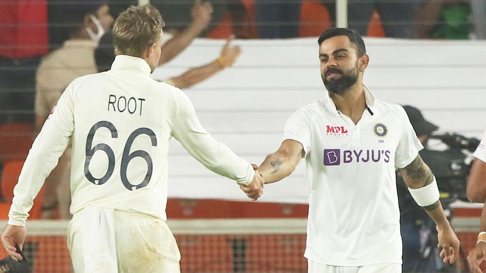 Indian captain Virat Kohli (pictured right) shakes hands with England captain Joe Root (pictured left).
