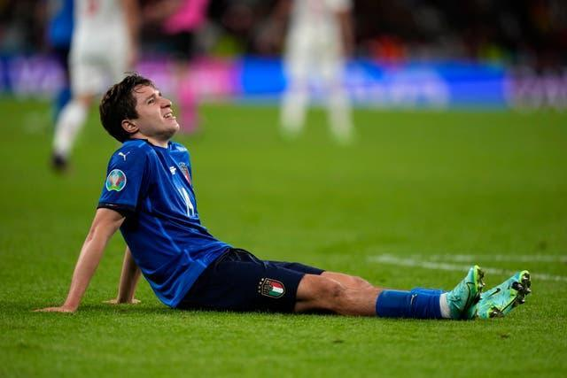Italy's Federico Chiesa sits down on the pitch during the semi-final against Spain