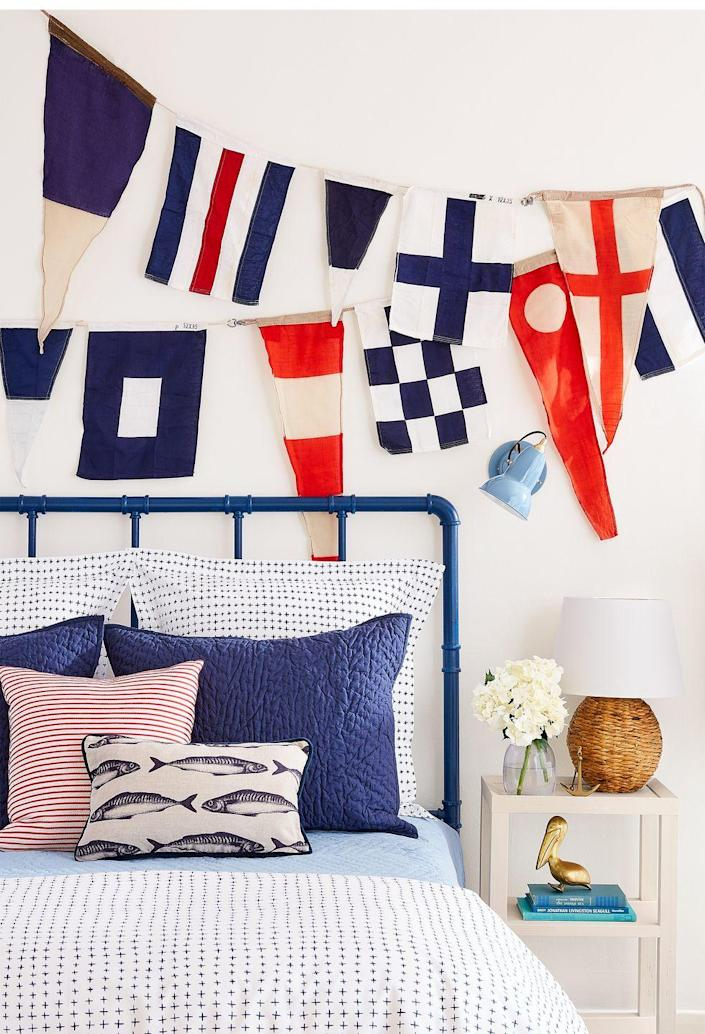 <p>Creating a nautical-themed bedroom doesn't have to be a challenge. Design around a red, white and blue color palette and don't miss the opportunity to showcase a flag collection.</p>