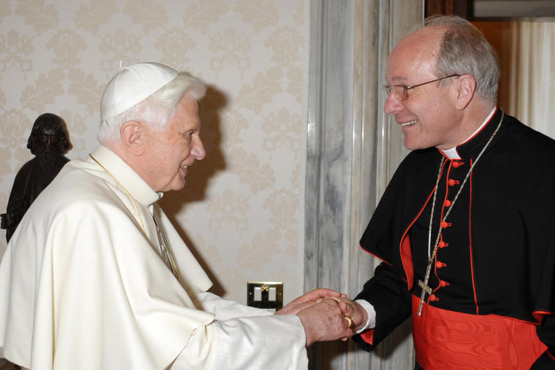 """FILE -- In this file picture taken at the Vatican on June 28, 2010 and made available by the Vatican newspaper Osservatore Romano, Pope Benedict XVI, left, shakes hands with Vienna's archbishop, Cardinal Christoph Schoenborn during their private meeting. Multilingual and respected by Jews, Muslims and Orthodox Christian, Benedict XVI's friend and former pupil was one of the cardinal electors in the 2005 papal conclave that chose the German as head of the Catholic church. A scholar who is at home in the pulpit, Schoenborn also is well connected in the Vatican _ and appears willing to make it his home, if reluctantly. Asked if he would like to succeed Benedict on news of the pontiff's plan to step down, he said: """"my heart is in Vienna, my heart is in Austria _ but naturally with the whole Church as well."""" (AP Photo/Osservatore Romano, HO)"""