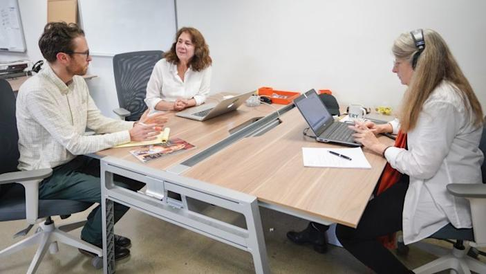 "Reporter Paige St. John, right, working on her ""Man in the Window"" podcast with senior producer and editor Karen Lowe and vice president of content George Lavender at Wondery. <span class=""copyright"">(L.A. Times Today)</span>"