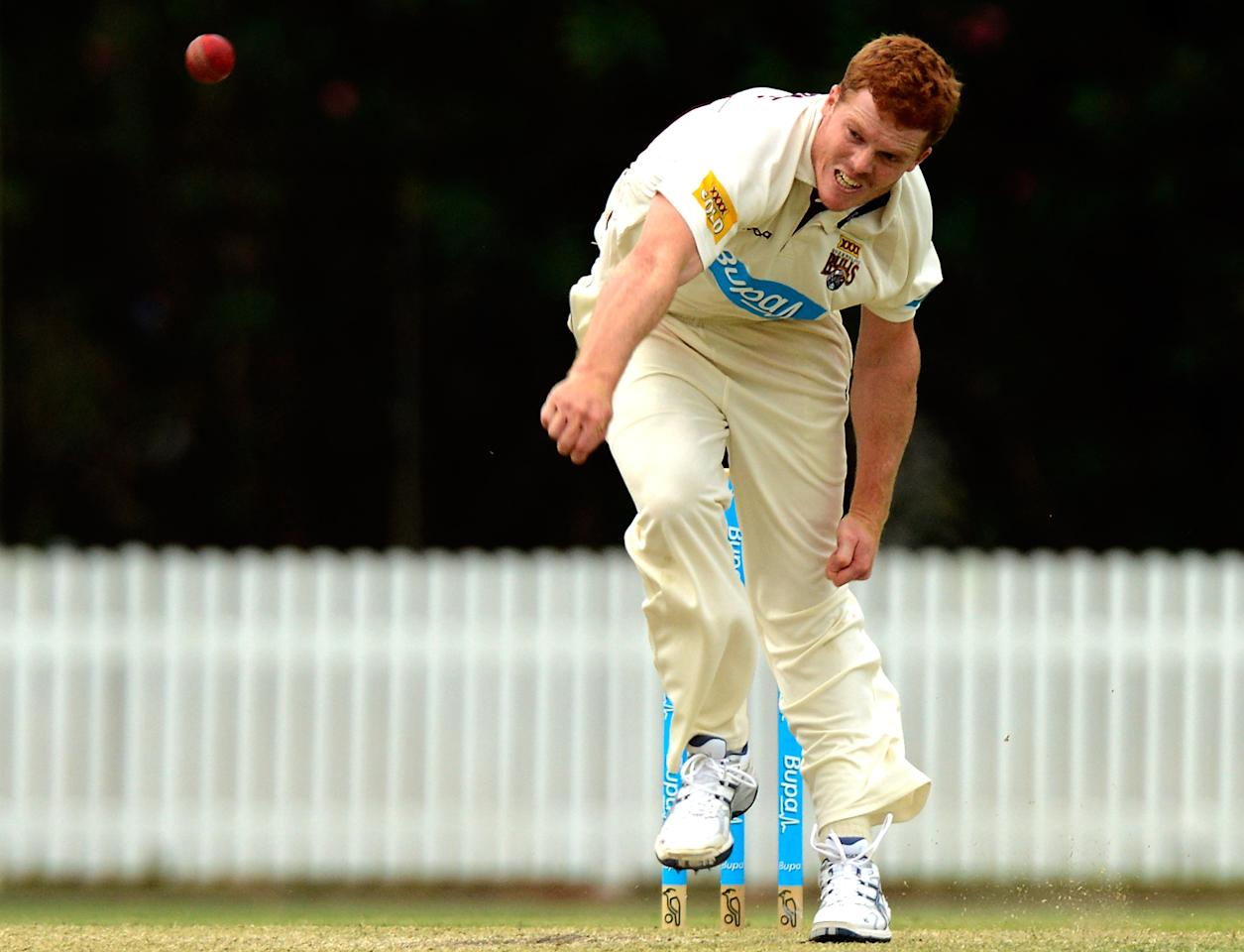 BRISBANE, AUSTRALIA - NOVEMBER 03:   Alister McDermott of the Bulls bowls during the Sheffield Shield match between the Queensland Bulls and the New South Wales Blues at Allan Border Field on November 3, 2012 in Brisbane, Australia.(Photo by Bradley Kanaris/Getty Images)