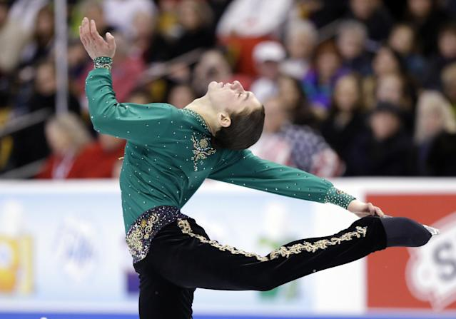 Jason Brown competes during the men's free skate at the U.S. Figure Skating Championships Sunday, Jan. 12, 2014 in Boston. (AP Photo/Steven Senne)