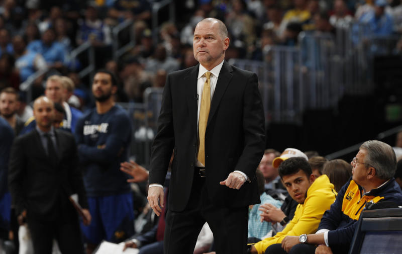 Denver Nuggets head coach Michael Malone watches in the first half of Game 5 of an NBA basketball first round playoff series against the San Antonio Spurs, Tuesday, April 23, 2019, in Denver. (AP Photo/David Zalubowski)