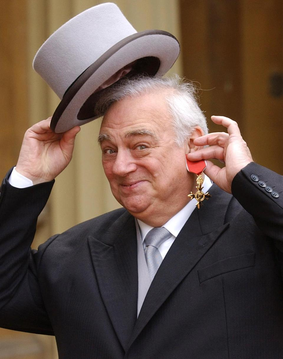 Comedian Roy Hudd holds his OBE for services to entertainment, at Buckingham Palace, London. Born in Croydon, Surrey, in 1936, Hudd started out as a Red Coat at Clacton on the Essex coast, alongside Harry Webb who later found fame and fortune as Cliff Richard.