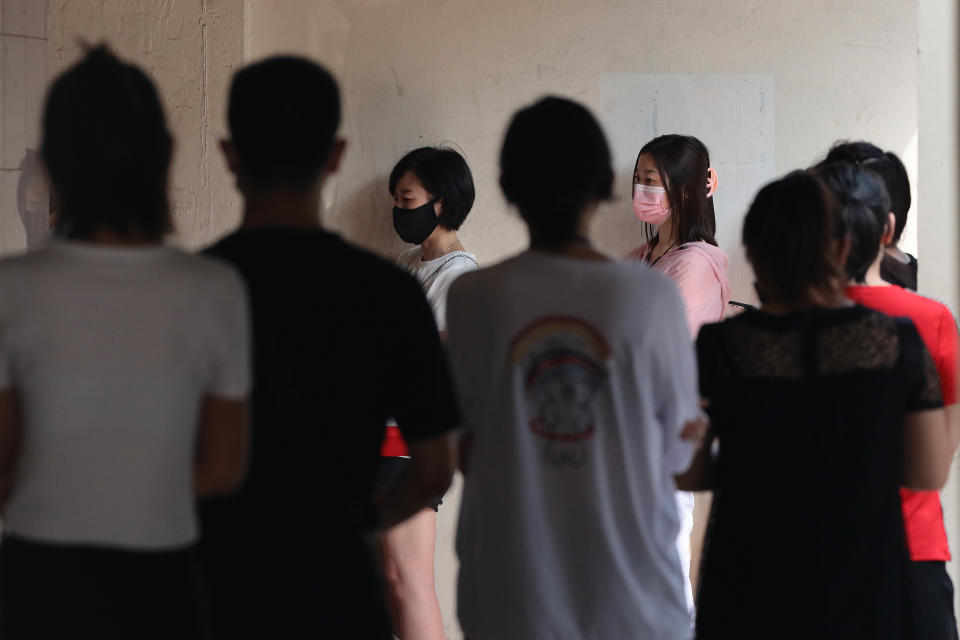 People wait in queue outside a clinic to receive the the China made COVID-19 Sinovac vaccine on June 24, 2021 in Singapore. Singapore allowed the usage of the Sinovac vaccine under the Special Access Route (SAR) framework even though the vaccine remains unregistered and is not authorised by the Health Sciences Authority (HSA). Under the SAR, COVID-19 vaccines approved by the World Health Organisation (WHO) for Emergency Use List (EUL) can be imported and supplied by private healthcare institutions. This will allow individuals an alternative to choose other than the city state approved vaccine, such as Pfzer-BioNTech and Moderna. (Photo by Suhaimi Abdullah/NurPhoto via Getty Images)