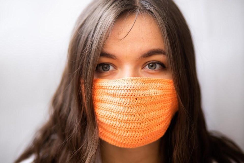 woman wearing a knitted mask