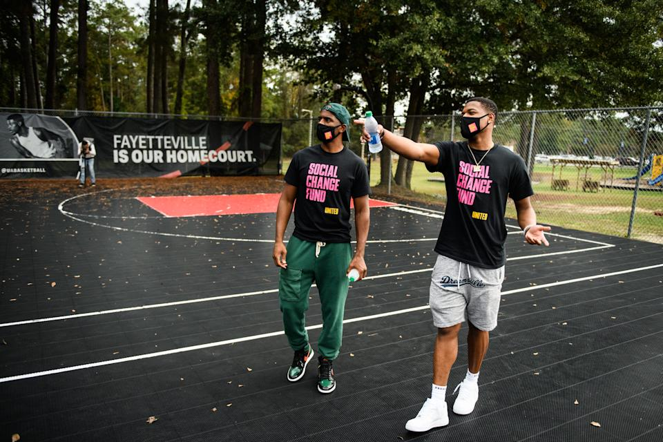 NBA player Dennis Smith Jr., right, shows fellow NBA player Chris Paul the basketball court at Smith Recreation Center on Wednesday, Oct. 28, 2020. Paul is traveling the country going to historically black colleges to get people to vote in the upcoming election.