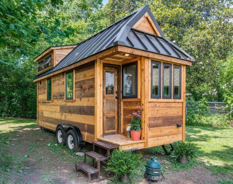 """<p>The Cedar Mountain Tiny House, built by Nashville-based <a class=""""link rapid-noclick-resp"""" href=""""http://www.newfrontiertinyhomes.com/"""" rel=""""nofollow noopener"""" target=""""_blank"""" data-ylk=""""slk:New Frontier Tiny Homes"""">New Frontier Tiny Homes</a>, might look small on the outside, but inside, it's big on farmhouse-style design. With repurposed accessories, <a href=""""http://www.homedepot.com/p/1-in-x-8-in-x-8-ft-Premium-Eastern-White-Pine-Shiplap-S1S-3-4-Rufferhead-Siding-3-Piece-Box-EHD0022828/205813138"""" rel=""""nofollow noopener"""" target=""""_blank"""" data-ylk=""""slk:shiplap walls"""" class=""""link rapid-noclick-resp"""">shiplap walls</a>, <a href=""""http://www.homedepot.com/p/Merola-Tile-Metro-Subway-Glossy-White-11-3-4-in-x-11-3-4-in-x-5-mm-Porcelain-Mosaic-Tile-9-6-sq-ft-case-FXLMSSW/100649499"""" rel=""""nofollow noopener"""" target=""""_blank"""" data-ylk=""""slk:subway tile"""" class=""""link rapid-noclick-resp"""">subway tile</a>, and rich hardwood floors, it's the perfect combination of rustic-chic and modern simplicity.<br></p><p><a class=""""link rapid-noclick-resp"""" href=""""https://www.amazon.com/Tiny-House-Floor-Plans-Interior-ebook/dp/B01JZX9WS8/?tag=syn-yahoo-20&ascsubtag=%5Bartid%7C10050.g.1887%5Bsrc%7Cyahoo-us"""" rel=""""nofollow noopener"""" target=""""_blank"""" data-ylk=""""slk:SHOP NOW"""">SHOP NOW</a> <a class=""""link rapid-noclick-resp"""" href=""""https://www.countryliving.com/home-design/a39493/modern-rustic-tiny-house/"""" rel=""""nofollow noopener"""" target=""""_blank"""" data-ylk=""""slk:SEE INSIDE"""">SEE INSIDE</a></p>"""