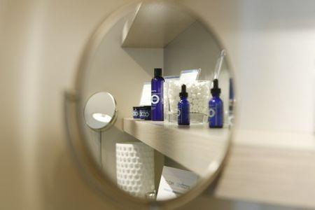Post and pre-injection medications sit on a shelf at a walk-in Botox salon in New York