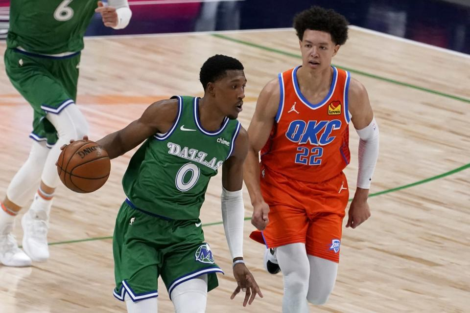 Dallas Mavericks guard Josh Richardson (0) advances the ball up court under pressure from Oklahoma City Thunder center Isaiah Roby (22) in the first half of an NBA basketball game in Dallas, Wednesday, March 3, 2021. (AP Photo/Tony Gutierrez)