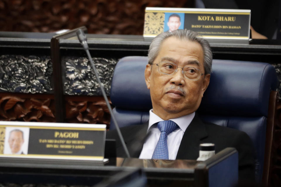 FILE - In this July 13, 2020, file photo, Malaysian Prime Minister Muhyiddin Yassin attends a Parliament session at lower house in Kuala Lumpur, Malaysia. Malaysia's government announced Monday, July 5, 2021 that Parliament will resume July 26, caving into pressure from the king to lift the legislature's suspension under a coronavirus emergency imposed in January. (AP Photo/Vincent Thian, File)