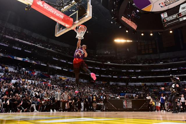 Donovan Mitchell of the Utah Jazz performs his final dunk en route to winning the Verizon Slam Dunk Contest at All-Star Saturday Night on Feb. 17, 2018. (Getty)