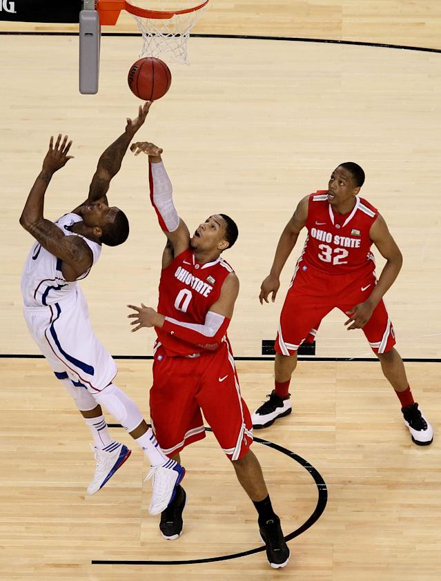 NEW ORLEANS, LA - MARCH 31: Thomas Robinson #0 of the Kansas Jayhawks puts up a shot over Jared Sullinger #0 of the Ohio State Buckeyes during the National Semifinal game of the 2012 NCAA Division I Men's Basketball Championship at the Mercedes-Benz Superdome on March 31, 2012 in New Orleans, Louisiana. (Photo by Ronald Martinez/Getty Images)