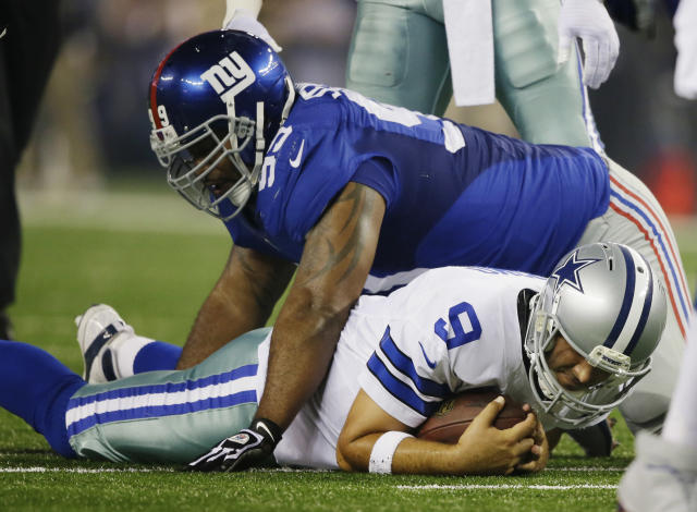 New York Giants defensive tackle Cullen Jenkins (99) sacks Dallas Cowboys quarterback Tony Romo (9) during the first half of an NFL football game Sunday, Sept. 8, 2013, in Arlington, Texas. (AP Photo/Tony Gutierrez)