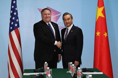 U.S. Secretary of State Mike Pompeo and China's Foreign Minister Wang Yi shake hands before their bilateral meeting at the 51st Association of Southeast Asian Nations (ASEAN) in Singapore