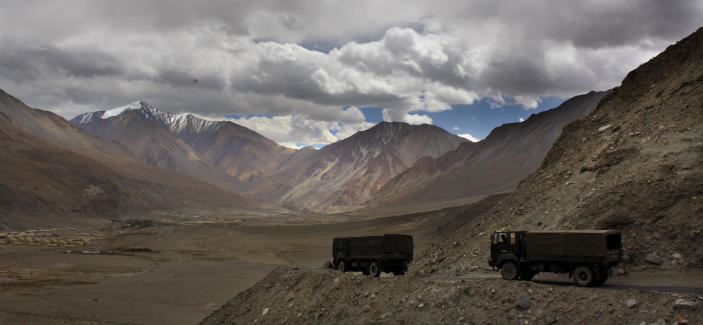 FILE- In this Sept. 14, 2017, file photo, Indian army trucks drive near Pangong Tso lake near the India China border in India's Ladakh area. The Indian army said Saturday, Jan. 9, 2020, that it has apprehended a Chinese soldier in the remote Ladakh region, where the two countries are locked in a monthslong military standoff along their disputed mountain border. An army statement said the Chinese soldier was taken into custody on Friday for transgressing into the Indian side in area South of Pangong Tso lake. (AP Photo/Manish Swarup)