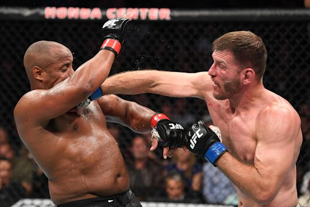 (R-L) Stipe Miocic punches Daniel Cormier in their heavyweight championship bout during UFC 241 at the Honda Center on Aug. 17, 2019 in Anaheim, California. (Getty Images)