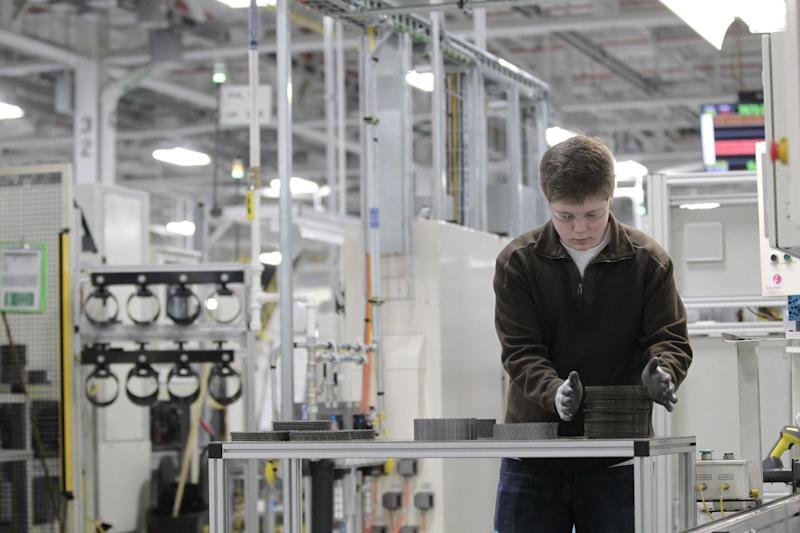 In this Thursday, Feb. 28, 2013 photo, Jordan Kenyon works on the assembly line during a media tour before an investment and jobs announcement event at the Chrysler transmission plant in Kokomo, Ind. Chrysler says its sales for February 2013 rose 4 percent from a year ago for the company's best February since 2008. (AP Photo/AJ Mast)