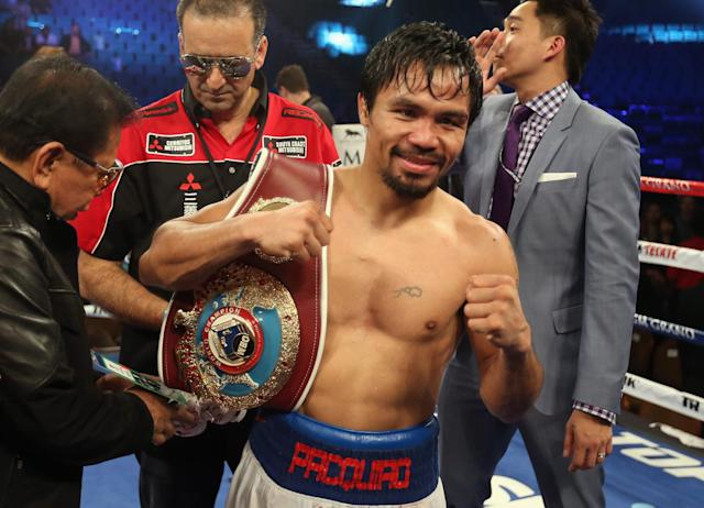 Manny Pacquiao celebrates his victory over Timothy Bradley at the MGM Grand Garden Arena on April 12, 2014 in Las Vegas, Nevada (AFP Photo/Jeff Gross)