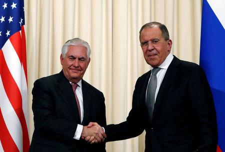 Russian Foreign Minister Sergei Lavrov shakes hands with U.S. Secretary of State Rex Tillerson during a news conference following their talks in Moscow