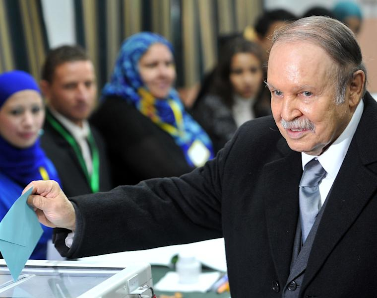 FILE - Algerian President Abdelaziz Bouteflika casts his ballot for local elections in Algiers, in this Thursday, Nov. 29, 2012 file photo. Algerian President Abdelaziz Bouteflika returned home Tuesday July 16. 2013 after 80 days of treatment in France following a stroke, the state news agency reported. (AP Photo / Anis Belghoul, file)