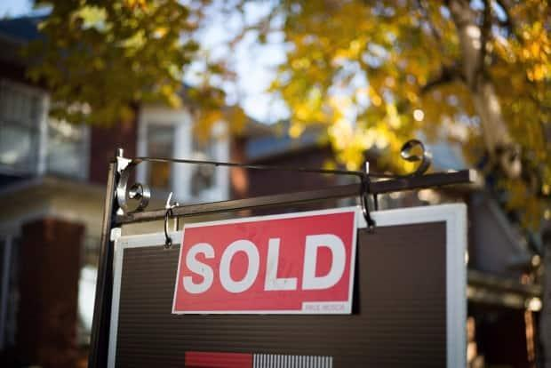 More and more buyers are fed up with the blind bidding process and losing out on multiple properties because they don't know where they stand compared to other competing buyers. (Graeme Roy/The Canadian Press - image credit)