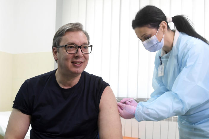 In this photo provided by the Serbian Presidential Press Service, Serbian President Aleksandar Vucic receives a dose of the Chinese Sinopharm vaccine in the village of Rudna Glava, Serbia, Tuesday, April 6, 2021. Vucic finally rolled up his sleeve for a coronavirus vaccine Tuesday and to encourage his country's increasingly skeptical Serbs to get vaccinated themselves. (Serbian Presidential Press Service via AP)