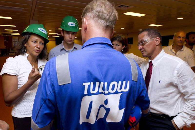 French Overseas Minister Marie-Luce Penchard (L) speaks with Tullow Oil company employees during a visit of an offshore oil platform on September 17, 2011 off the coasts of the French overseas department of Guiana. Anglo Dutch energy giant Shell announced on September 9, 2011 that it had discovered oil in deep waters around 150 kilometres (90 miles) off the coast of French Guiana following a joint venture drilling project with venture energy partners Total, Tullow and Northpet. AFP PHOTO / JODY AMIET (Photo credit should read JODY AMIET/AFP via Getty Images)