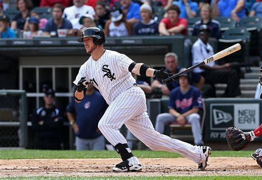 Chicago White Sox' Tyler Flowers delivers an RBI double to give the White Sox a 1-0 lead over the Cleveland Indians in the second inning of a baseball game in Chicago, Saturday, June 29, 2013. (AP Photo/Charles Cherney)