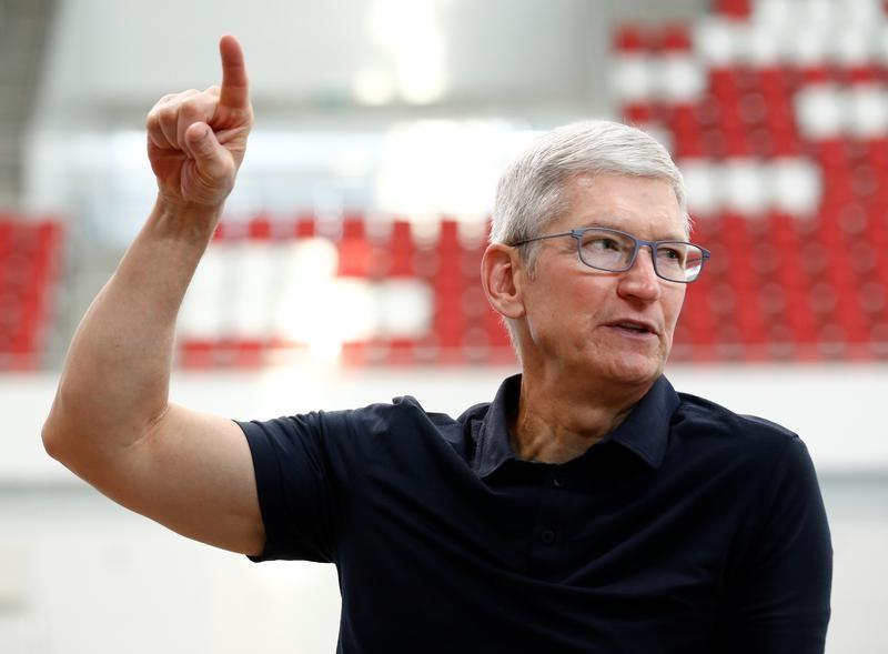 Apple's CEO Tim Cook speaks with Singapore Paralympian Theresa Goh (unseen) at the OCBC Aquatic Centre, Singapore Sports Hub