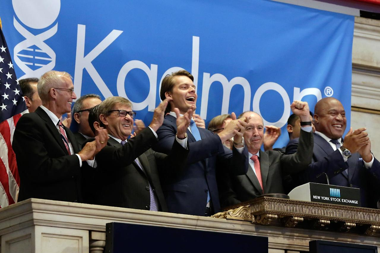 Kadmon Holdings President & CEO Harlan Waksal, second from right, is applauded as he rings the opening bell to celebrate his company's IPO at the New York Stock Exchange, Wednesday, July 27, 2016. He is joined by company officials including CFO Konstantin Poukalov, center. (AP Photo/Richard Drew)