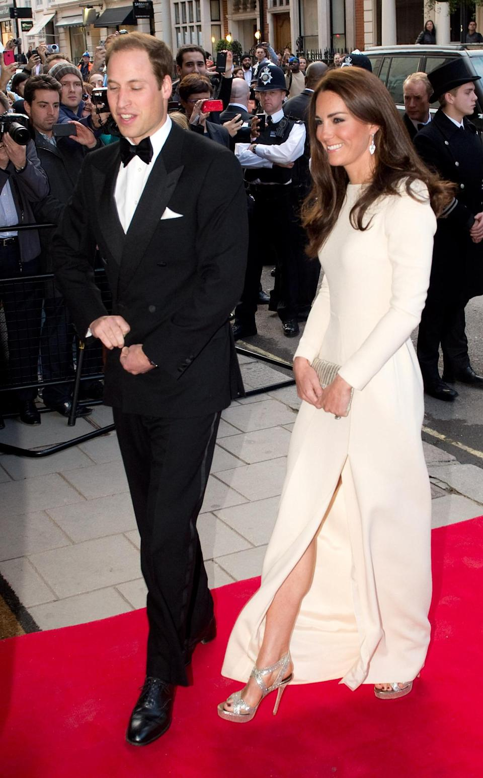 <p>Kate donned a chic white Roland Mouret evening gown for a dinner at Claridge's. She wore her favourite gold Jimmy Choos and opted for a beaded vintage clutch.</p><p><i>[Photo: PA]</i></p>