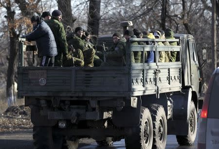 Pro-Russian separatists ride on a truck near the village of Hrabove (Grabovo) in Donetsk region, eastern Ukraine November 20, 2014. REUTERS/Antonio Bronic